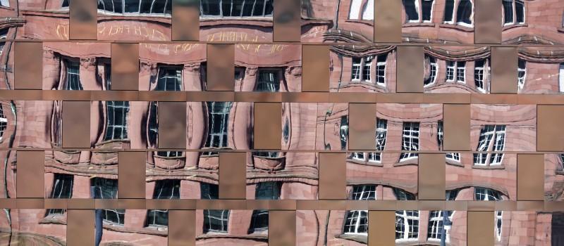 Wir erkennen uns im anderen: Als Abbild oder Zerrbild? Kollegiengebäude I in Freiburg sich spiegelnd in der neuen Universitätsbibliothek.